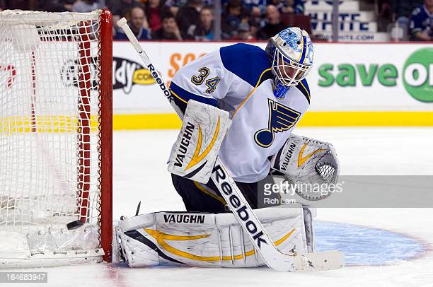 Goalie Jake Allen of the St Louis Blues makes a save during NHL action against the Vancouver Canucks on March 19 2013 at Rogers Arena in Vancouver...