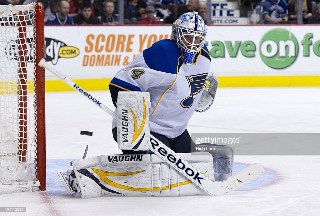 Goalie Jake Allen #34 of the St. Louis Blues steers the puck aside after making a save against the Vancouver Canucks during the third period in NHL action on March 19, 2013 at Rogers Arena in Vancouver, British Columbia, Canada.
