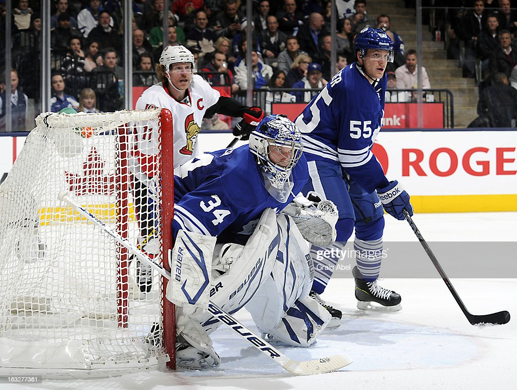 Goalie James Reimer #34 and Korbinian Holzer #55 of the Toronto Maple Leafs defend as Daniel Alfredsson #11 of the Ottawa Senators looks on during NHL game action March 6, 2013 at the Air Canada Centre in Toronto, Ontario, Canada.