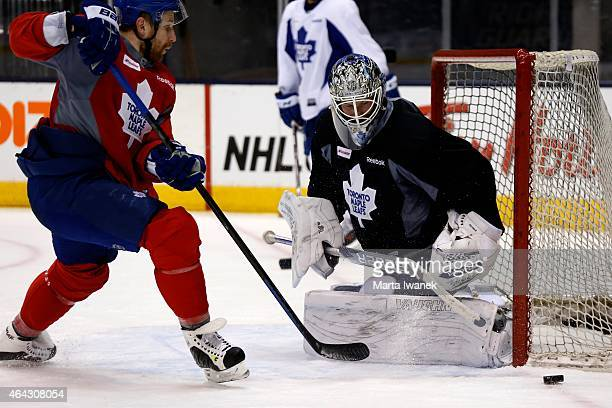 Goalie James Reimer blocks a shot from centre Leo Komarov during the Toronto Maple Leafs practice held at the Air Canada Centre