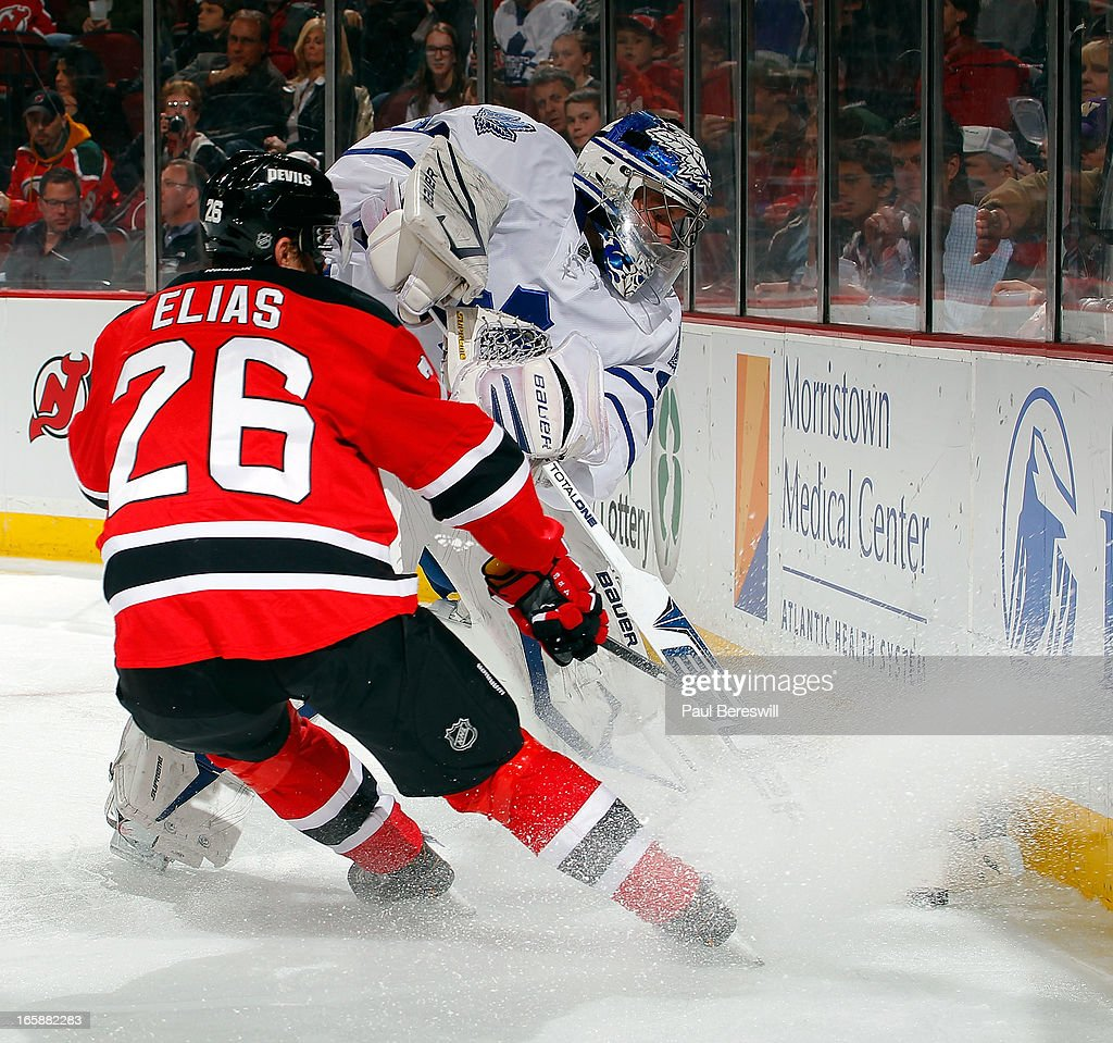 Goalie James Reimer #34 of the Toronto Maple Leafs clears the puck from in front of Patrik Elias #26 of the New Jersey Devils during the second period at an NHL hockey game at Prudential Center on April 6, 2013 in Newark, New Jersey. The Leafs won 2-1.