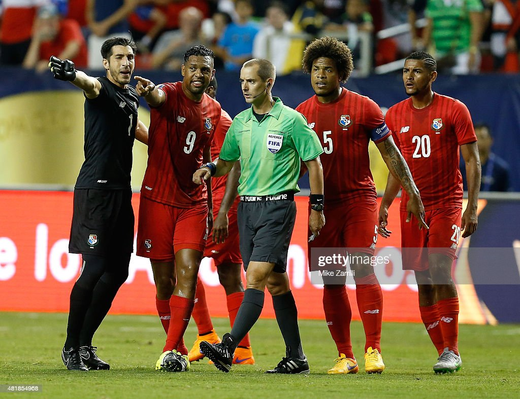 Goalie Jamie Penedo #1, Roberto Nurse #9, Roman Torres #5 and Anibal Godoy #20 of Panama argue with referee <a gi-track='captionPersonalityLinkClicked' href=/galleries/search?phrase=Mark+Geiger&family=editorial&specificpeople=1459799 ng-click='$event.stopPropagation()'>Mark Geiger</a> (center) during the 2015 CONCACAF Gold Cup semifinal match against Mexico at Georgia Dome on July 22, 2015 in Atlanta, Georgia.