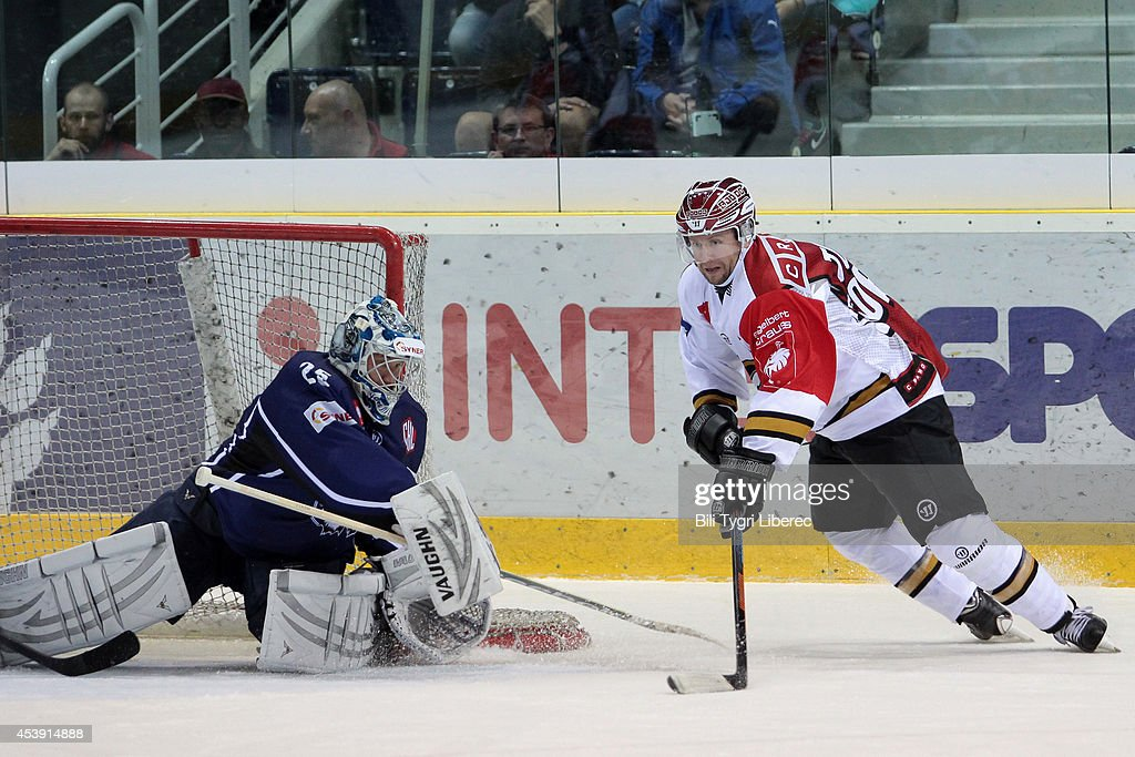 Goalie Jan Lasak of Bili Tygri Liberec saves the puck and Ivan Huml of Karpat Oulu during the Champions Hockey League group stage game between Bili Tygri Liberec and Karpat Oulu on August 21, 2014 in Liberec, Czech Republic.