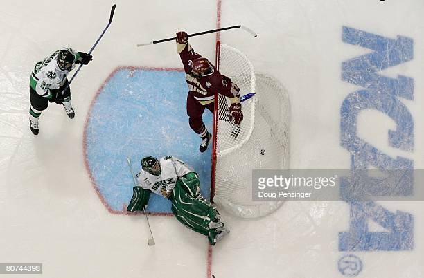 Goalie JeanPhilippe Lamoureux of North Dakota lies on the ice as Mike Brennan of the Boston College celebrates a goal by hos team during semifinal...
