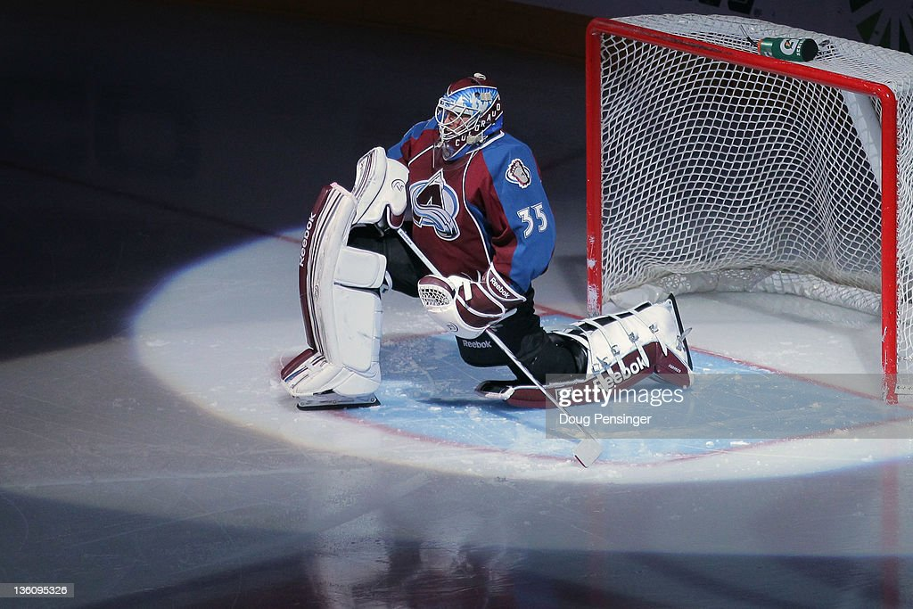 Goalie <a gi-track='captionPersonalityLinkClicked' href=/galleries/search?phrase=Jean-Sebastien+Giguere&family=editorial&specificpeople=202814 ng-click='$event.stopPropagation()'>Jean-Sebastien Giguere</a> #35 of the Colorado Avalanche prepares to face the Tampa Bay Lightning at the Pepsi Center on December 23, 2011 in Denver, Colorado. The Avalanche defeated the Lightning 2-1 in overtime.