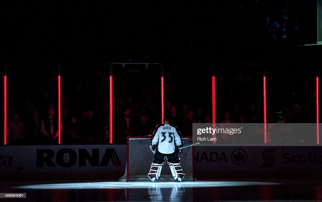 Goalie <a gi-track='captionPersonalityLinkClicked' href=/galleries/search?phrase=Jean-Sebastien+Giguere&family=editorial&specificpeople=202814 ng-click='$event.stopPropagation()'>Jean-Sebastien Giguere</a> #35 of the Colorado Avalanche stands in his crease while the national anthem is sung prior to NHL action against the Vancouver Canucks on December 08, 2013 at Rogers Arena in Vancouver, British Columbia, Canada.