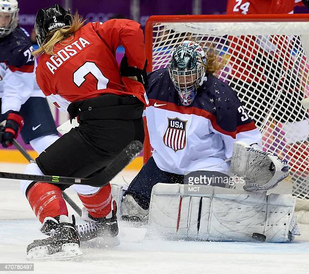 USA goalie Jessie Vetter stops a shot by Canada forward Meghan AgostaMarciano during the second period of the women's Gold Medal hockey game at the...