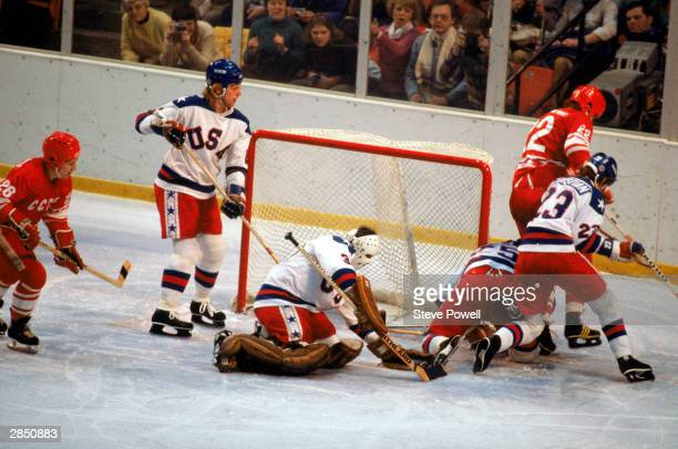 Goalie Jim Craig and his teammate Mike Ramsey of the United States protect the goal during the Olympic hockey game against the Soviet Union on...