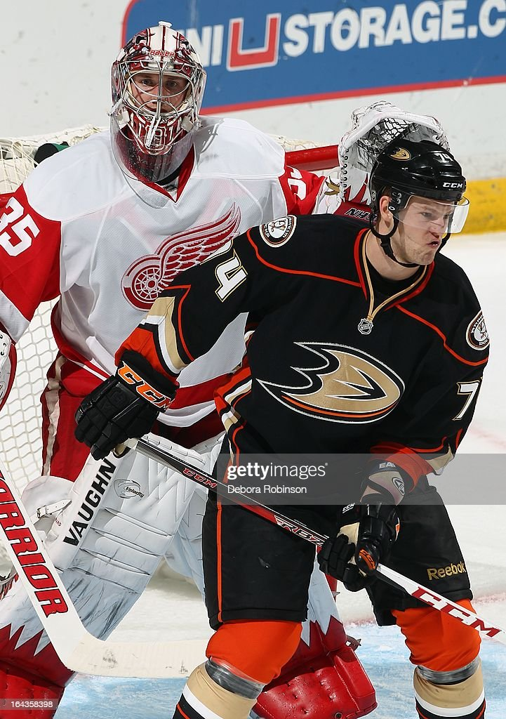Goalie <a gi-track='captionPersonalityLinkClicked' href=/galleries/search?phrase=Jimmy+Howard&family=editorial&specificpeople=2118637 ng-click='$event.stopPropagation()'>Jimmy Howard</a> #35 mixes it up with Peter Holland #74 of the Anaheim Ducks. March 22, 2013 at Honda Center in Anaheim, California.