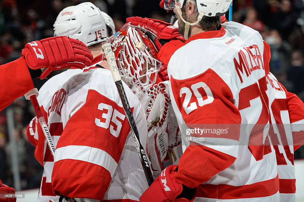 Goalie Jimmy Howard of the Detroit Red Wings celebrates after defeating the Chicago Blackhawks 32 during the NHL game at the United Center on...