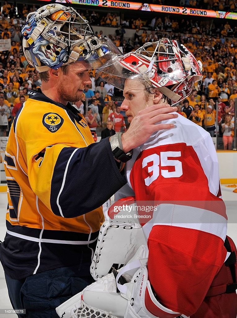 Goalie <a gi-track='captionPersonalityLinkClicked' href=/galleries/search?phrase=Jimmy+Howard&family=editorial&specificpeople=2118637 ng-click='$event.stopPropagation()'>Jimmy Howard</a> #35 of the Detroit Red Wings congratulates <a gi-track='captionPersonalityLinkClicked' href=/galleries/search?phrase=Pekka+Rinne&family=editorial&specificpeople=2118342 ng-click='$event.stopPropagation()'>Pekka Rinne</a> #35 of the Nashville Predators on winning Game Five of the Western Conference Quarterfinals during the 2012 NHL Stanley Cup Playoffs at the Bridgestone Arena on April 20, 2012 in Nashville, Tennessee.