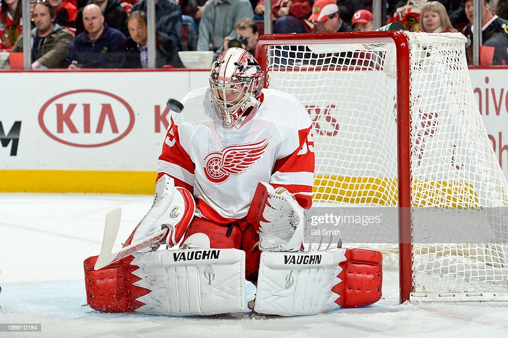 Goalie Jimmy Howard #35 of the Detroit Red Wings gets in position to block the puck against the Chicago Blackhawks during the NHL game on April 12, 2013 at the United Center in Chicago, Illinois.