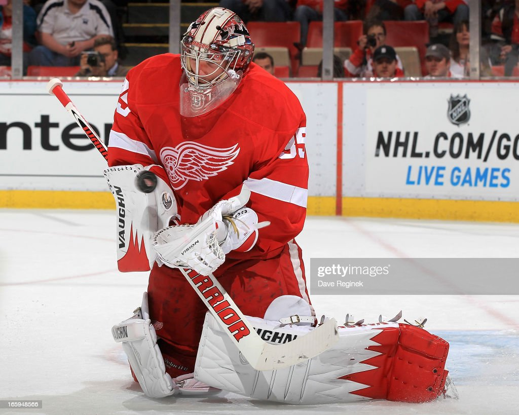 Goalie <a gi-track='captionPersonalityLinkClicked' href=/galleries/search?phrase=Jimmy+Howard&family=editorial&specificpeople=2118637 ng-click='$event.stopPropagation()'>Jimmy Howard</a> #35 of the Detroit Red Wings makes a save during a NHL game against the St. Louis Blues at Joe Louis Arena on April 7, 2013 in Detroit, Michigan.