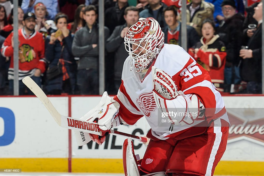 Goalie <a gi-track='captionPersonalityLinkClicked' href=/galleries/search?phrase=Jimmy+Howard&family=editorial&specificpeople=2118637 ng-click='$event.stopPropagation()'>Jimmy Howard</a> #35 of the Detroit Red Wings reacts after the Red Wings defeated the Chicago Blackhawks 3-2 during the NHL game at the United Center on February 18, 2015 in Chicago, Illinois.