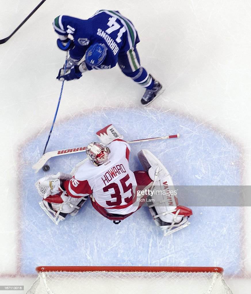 Goalie <a gi-track='captionPersonalityLinkClicked' href=/galleries/search?phrase=Jimmy+Howard&family=editorial&specificpeople=2118637 ng-click='$event.stopPropagation()'>Jimmy Howard</a> #35 of the Detroit Red Wings stops <a gi-track='captionPersonalityLinkClicked' href=/galleries/search?phrase=Alexandre+Burrows&family=editorial&specificpeople=592489 ng-click='$event.stopPropagation()'>Alexandre Burrows</a> #14 of the Vancouver Canucks in close during the second period in NHL action on April 20, 2013 at Rogers Arena in Vancouver, British Columbia, Canada.