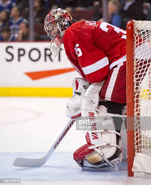 Goalie Jimmy Howard of the Detroit Red Wings waits for the play with resume during a break in NHL action against the Vancouver Canucks on November 06...