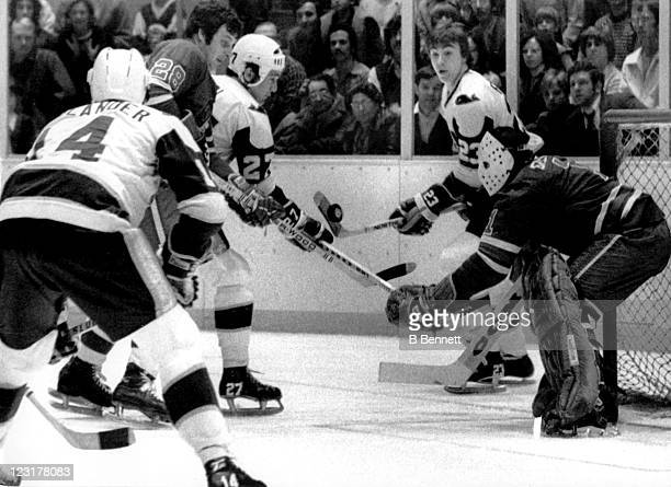 Goalie Joe Daley of the Winninpeg Jets follows the puck as his teammate Al Beaule tries to hold off Al Karlander Tom Earl and Nick Fotiu of the New...