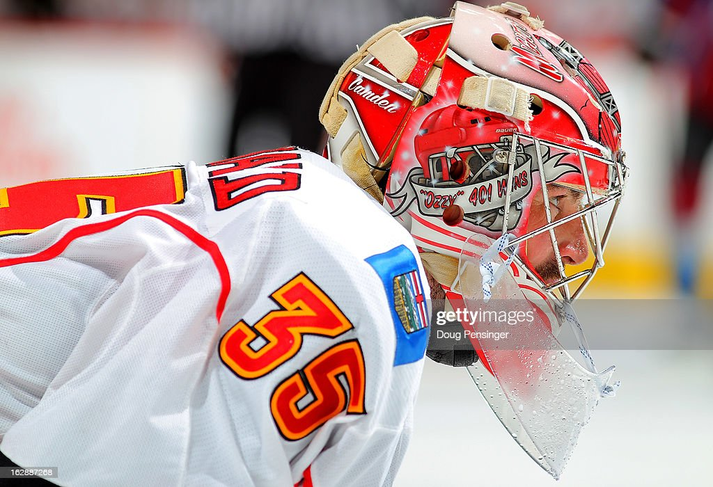 Goalie <a gi-track='captionPersonalityLinkClicked' href=/galleries/search?phrase=Joey+MacDonald&family=editorial&specificpeople=2234367 ng-click='$event.stopPropagation()'>Joey MacDonald</a> #35 of the Calgary Flames looks on during a break in the action against the Colorado Avalanche at the Pepsi Center on February 28, 2013 in Denver, Colorado. The Avalanche defeated the Flames 5-4.