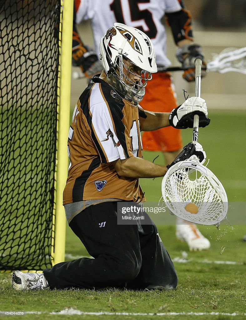 Goalie John Galloway #15 of the Rochester Rattlers makes a save during the 2014 Major League Lacrosse Championship Game against the Denver Outlaws at Fifth Third Bank Stadium on August 23, 2014 in Kennesaw, Georgia.