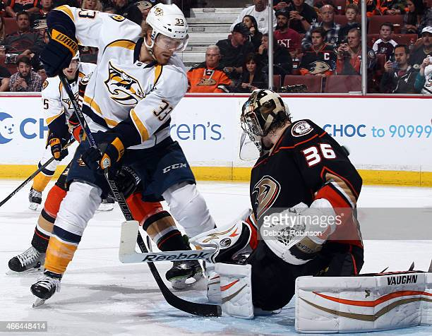 Goalie John Gibson of the Anaheim Ducks stops a shot by Colin Wilson of the Nashville Predators on March 15 2015 at Honda Center in Anaheim California