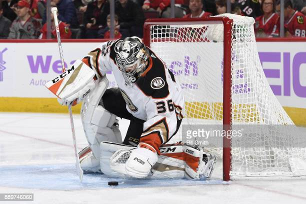 Goalie John Gibson of the Anaheim Ducks stops the puck in the first period against the Chicago Blackhawks at the United Center on November 27 2017 in...