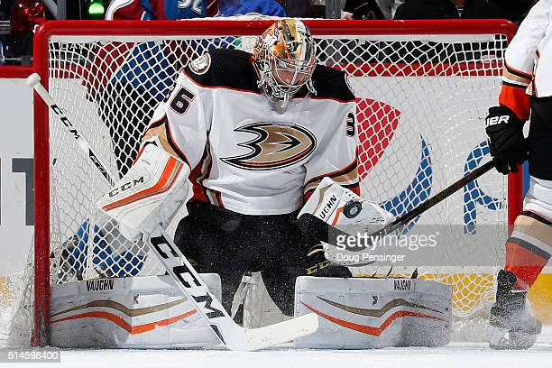 Goalie John Gibson of the Anaheim Ducks turns the puck away against the Colorado Avalanche at Pepsi Center on March 9 2016 in Denver Colorado The...