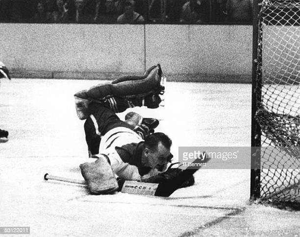 Goalie Johnny Bower dives to make the save during an NHL game against the New York Rangers on February 28 1965 at Madison Squre Garden in New York...