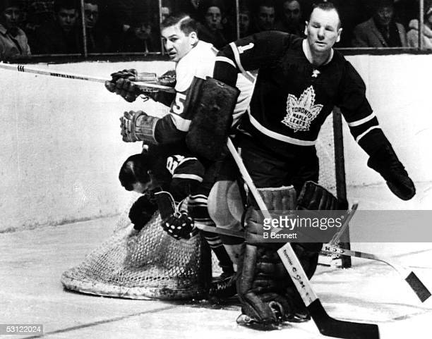 Goalie Johnny Bower of the Toronto Maple Leafs looks on during an NHL game against the Detroit Red Wings circa 1960's at Maple Leaf Gardens in...