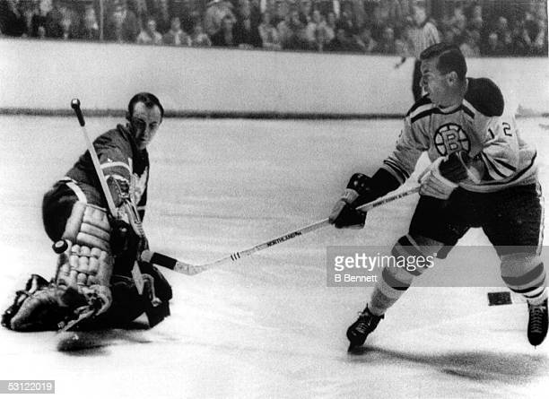 Goalie Johnny Bower of the Toronto Maple Leafs makes the pad save on Ron Stewart of the Boston Bruins on March 6 1966 at the Boston Garden in Boston...