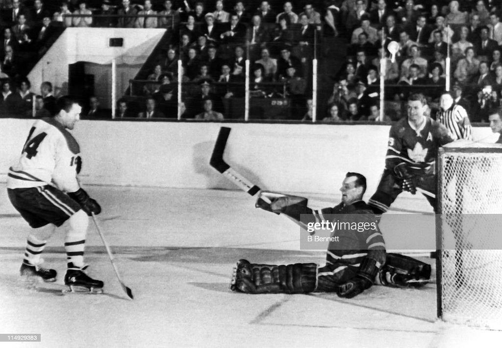 Goalie <a gi-track='captionPersonalityLinkClicked' href=/galleries/search?phrase=Johnny+Bower&family=editorial&specificpeople=239053 ng-click='$event.stopPropagation()'>Johnny Bower</a> #1 of the Toronto Maple Leafs makes the save on the shot by Claude Provost #14 of the Montreal Canadiens on October 28, 1964 at the Maple Leaf Gardens in Toronto, Ontario, Canada.