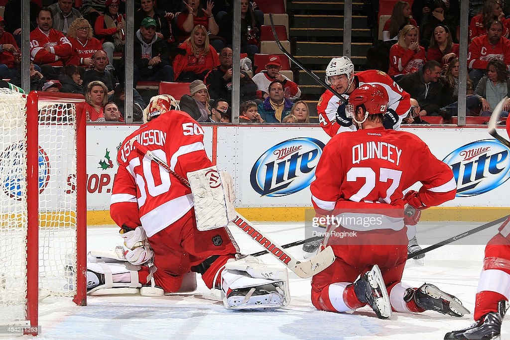 Goalie <a gi-track='captionPersonalityLinkClicked' href=/galleries/search?phrase=Jonas+Gustavsson&family=editorial&specificpeople=886789 ng-click='$event.stopPropagation()'>Jonas Gustavsson</a> #50 of the Detroit Red Wings and teammate <a gi-track='captionPersonalityLinkClicked' href=/galleries/search?phrase=Kyle+Quincey&family=editorial&specificpeople=2234340 ng-click='$event.stopPropagation()'>Kyle Quincey</a> #27 both drop to their knees to block a shot from <a gi-track='captionPersonalityLinkClicked' href=/galleries/search?phrase=Brad+Boyes&family=editorial&specificpeople=275014 ng-click='$event.stopPropagation()'>Brad Boyes</a> #24 of the Florida Panthers during an NHL game at Joe Louis Arena on December 7, 2013 in Detroit, Michigan.