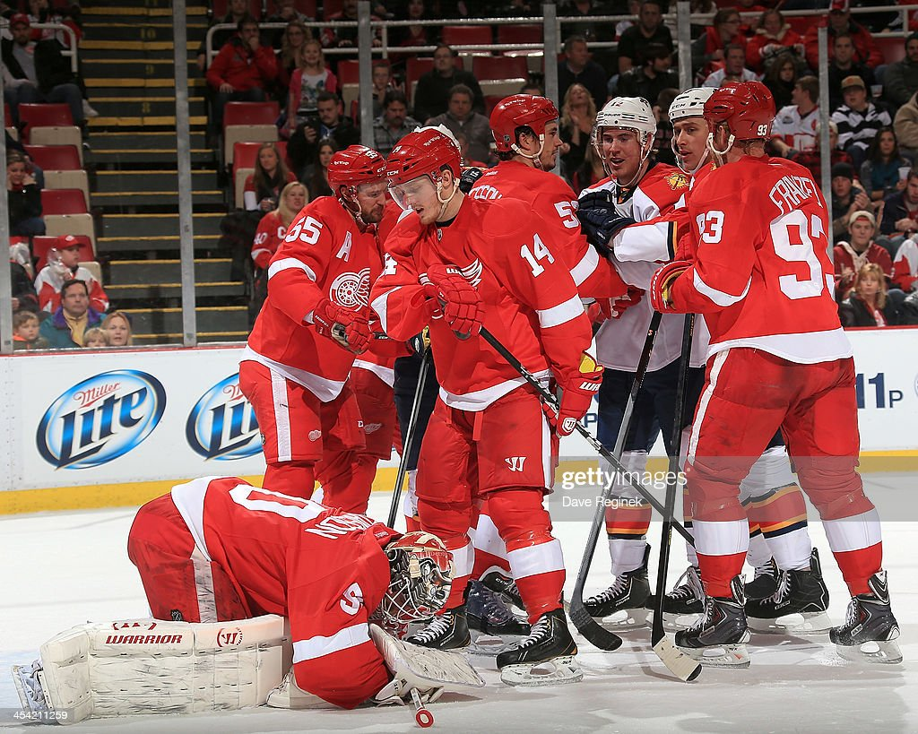Goalie <a gi-track='captionPersonalityLinkClicked' href=/galleries/search?phrase=Jonas+Gustavsson&family=editorial&specificpeople=886789 ng-click='$event.stopPropagation()'>Jonas Gustavsson</a> #50 of the Detroit Red Wings covers the puck as teammates <a gi-track='captionPersonalityLinkClicked' href=/galleries/search?phrase=Niklas+Kronwall&family=editorial&specificpeople=220826 ng-click='$event.stopPropagation()'>Niklas Kronwall</a> #55, <a gi-track='captionPersonalityLinkClicked' href=/galleries/search?phrase=Jonathan+Ericsson&family=editorial&specificpeople=2538498 ng-click='$event.stopPropagation()'>Jonathan Ericsson</a> #52, <a gi-track='captionPersonalityLinkClicked' href=/galleries/search?phrase=Johan+Franzen&family=editorial&specificpeople=624356 ng-click='$event.stopPropagation()'>Johan Franzen</a> #93 and <a gi-track='captionPersonalityLinkClicked' href=/galleries/search?phrase=Gustav+Nyquist&family=editorial&specificpeople=5491209 ng-click='$event.stopPropagation()'>Gustav Nyquist</a> #14 protect the front of the net from Jimmy Hayes #12 and Shawn Matthias #18 of the Florida Panthers during an NHL game at Joe Louis Arena on December 7, 2013 in Detroit, Michigan.