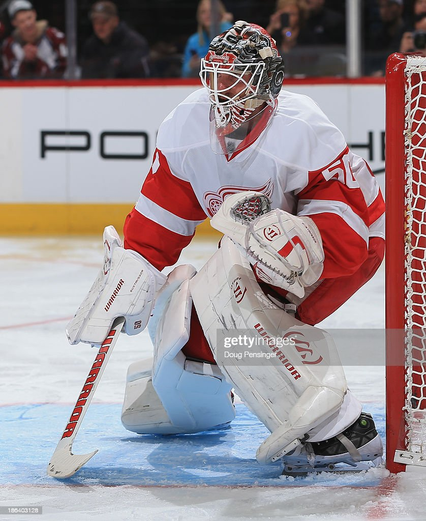 Goalie <a gi-track='captionPersonalityLinkClicked' href=/galleries/search?phrase=Jonas+Gustavsson&family=editorial&specificpeople=886789 ng-click='$event.stopPropagation()'>Jonas Gustavsson</a> #50 of the Detroit Red Wings defends the goal and had 38 saves against the Colorado Avalanche at Pepsi Center on October 17, 2013 in Denver, Colorado. The Red Wings defeated the Avalanche 4-2.