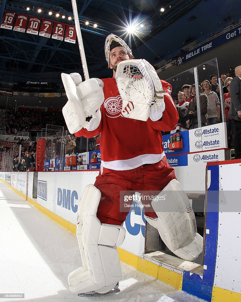 Goalie <a gi-track='captionPersonalityLinkClicked' href=/galleries/search?phrase=Jonas+Gustavsson&family=editorial&specificpeople=886789 ng-click='$event.stopPropagation()'>Jonas Gustavsson</a> #50 of the Detroit Red Wings salutes the crowd after being awarded the first star of the NHL game against the Montreal Canadiens on January 24, 2014 at Joe Louis Arena in Detroit, Michigan. Detroit defeated Montreal 4-1