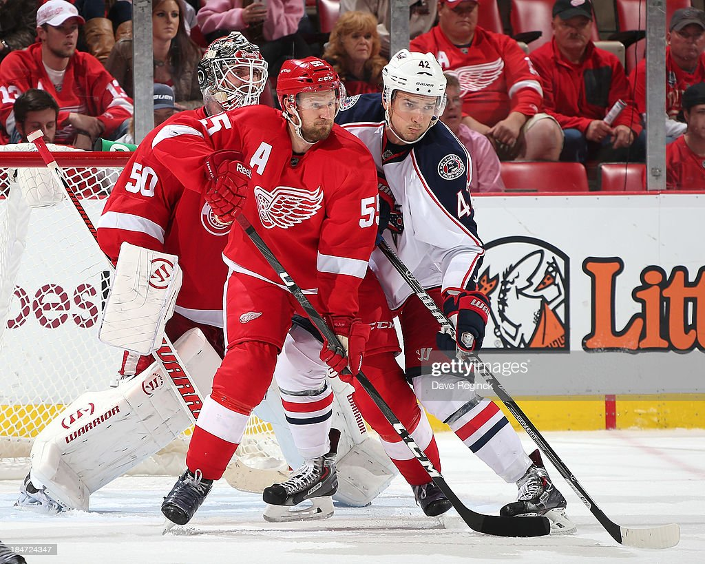 Goalie <a gi-track='captionPersonalityLinkClicked' href=/galleries/search?phrase=Jonas+Gustavsson&family=editorial&specificpeople=886789 ng-click='$event.stopPropagation()'>Jonas Gustavsson</a> #50 of the Detroit Red Wings watches the play as teammate <a gi-track='captionPersonalityLinkClicked' href=/galleries/search?phrase=Niklas+Kronwall&family=editorial&specificpeople=220826 ng-click='$event.stopPropagation()'>Niklas Kronwall</a> #55 battles with <a gi-track='captionPersonalityLinkClicked' href=/galleries/search?phrase=Artem+Anisimov&family=editorial&specificpeople=543215 ng-click='$event.stopPropagation()'>Artem Anisimov</a> #42 of the Columbus Blue Jackets battle in front of the net during a NHL game at Joe Louis Arena on October 15, 2013 in Detroit, Michigan. Detroit defeated Columbus 2-1