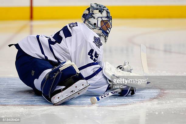 Goalie Jonathan Bernier of the Toronto Maple Leafs stretches in the second period against the Washington Capitals at Verizon Center on March 2 2016...