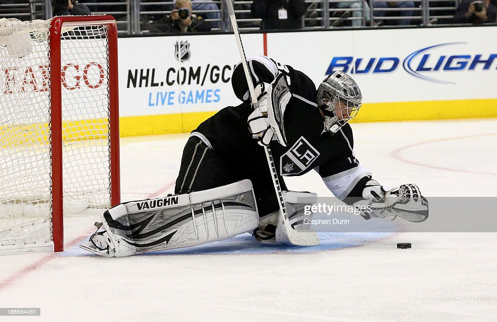 Goalie <a gi-track='captionPersonalityLinkClicked' href=/galleries/search?phrase=Jonathan+Quick&family=editorial&specificpeople=2271852 ng-click='$event.stopPropagation()'>Jonathan Quick</a> #32 of the Los Angeles Kings covers the puck in the game against the Anaheim Ducks at Staples Center on April 13, 2013 in Los Angeles, California. The Kings won 2-1.