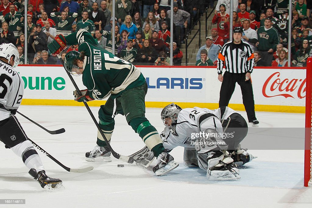 Goalie <a gi-track='captionPersonalityLinkClicked' href=/galleries/search?phrase=Jonathan+Quick&family=editorial&specificpeople=2271852 ng-click='$event.stopPropagation()'>Jonathan Quick</a> #32 of the Los Angeles Kings makes a save against <a gi-track='captionPersonalityLinkClicked' href=/galleries/search?phrase=Dany+Heatley&family=editorial&specificpeople=202142 ng-click='$event.stopPropagation()'>Dany Heatley</a> #15 of the Minnesota Wild during the game on March 30, 2013 at the Xcel Energy Center in Saint Paul, Minnesota.