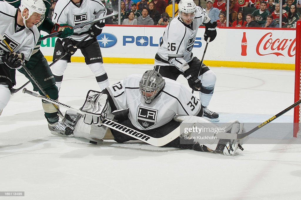 Goalie <a gi-track='captionPersonalityLinkClicked' href=/galleries/search?phrase=Jonathan+Quick&family=editorial&specificpeople=2271852 ng-click='$event.stopPropagation()'>Jonathan Quick</a> #32 of the Los Angeles Kings makes a save during the game against the Minnesota Wild on March 30, 2013 at the Xcel Energy Center in Saint Paul, Minnesota.