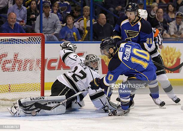 Goalie Jonathan Quick of the Los Angeles Kings makes a stop on a shot by Andy McDonald of the St Louis Blues in Game One of the Western Conference...