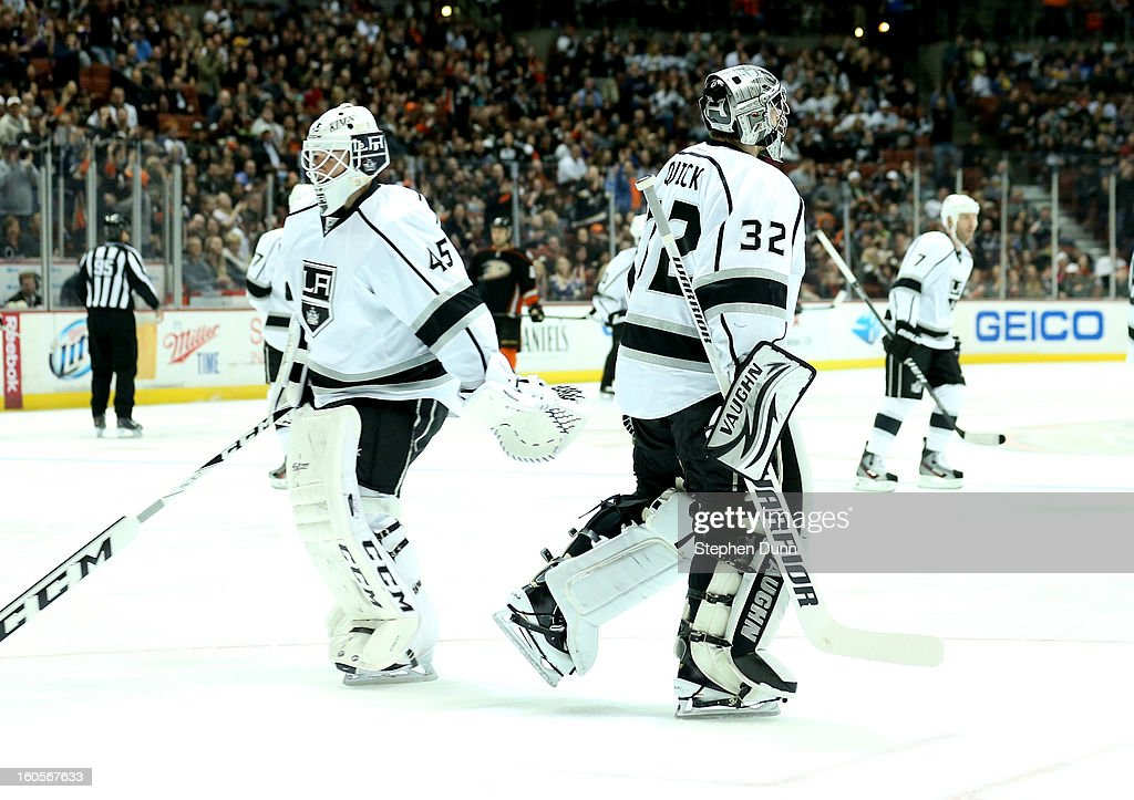 Goalie Jonathan Quick #32 of the Los Angeles Kings skates off the ice as he is pulled after allowing two first period goals and replaced by Jonathan Bernier #45 against the Anaheim Ducks at Honda Center on February 2, 2013 in Anaheim, California.