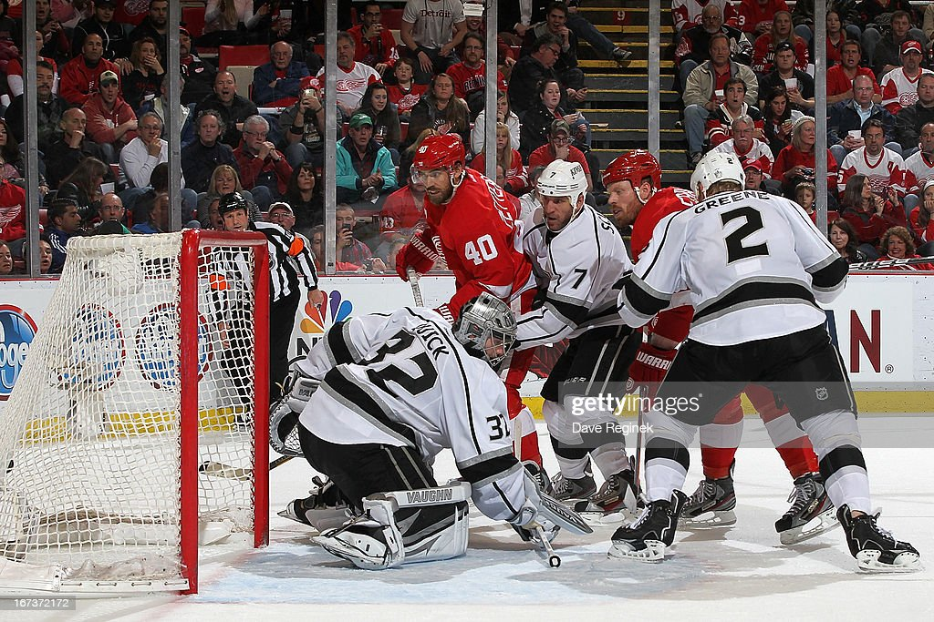 Goalie Jonathan Quick #32, Rob Scuderi #7 and Matt Greene #2 of the Los Angeles Kings watch the puck go to the back of the net as Johan Franzen #93 of the Detroit Red Wings scores from a pass by teamate Henrik Zetterberg #40 during a NHL game at Joe Louis Arena on April 24, 2013 in Detroit, Michigan.