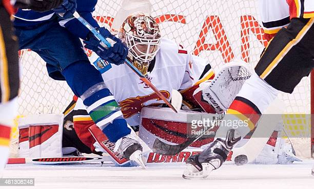Goalie Joni Ortio of the Calgary Flames stretches to make a pad save during the first period against the Vancouver Canucks in NHL action on January...