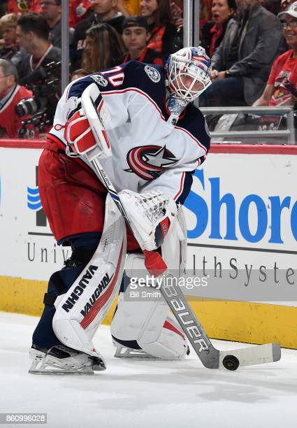 Goalie Joonas Korpisalo of the Columbus Blue Jackets approaches the puck during the game against the Chicago Blackhawks at the United Center on...