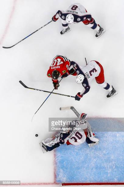 Goalie Joonas Korpisalo of the Columbus Blue Jackets stops a shot by John Hayden of the Chicago Blackhawks at the United Center on October 7 2017 in...