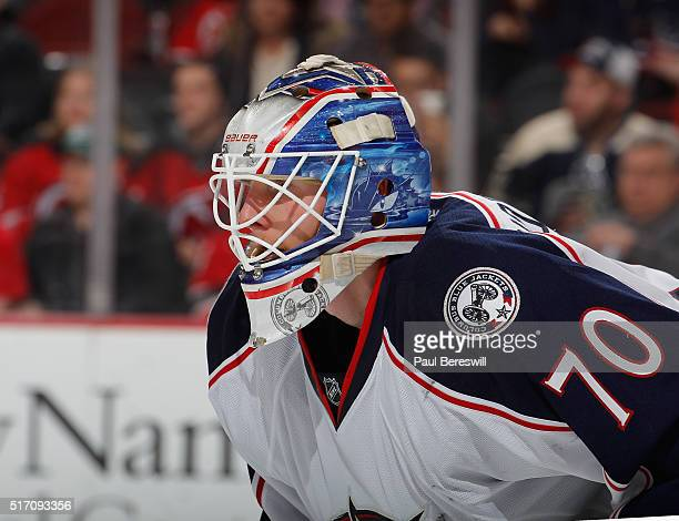 Goalie Joonas Korpisalo of the Columbus Blue Jackets waits for a faceoff during an NHL hockey game against the New Jersey Devils at Prudential Center...