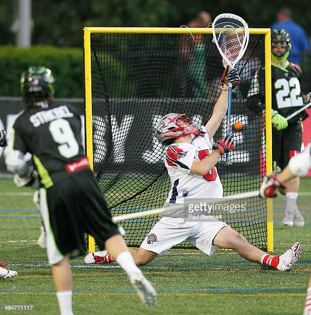 Goalie Jordan Burke of the Boston Cannons can't make a save on this shot by Matt Striebel of the New York Lizards for goal in the first half of a...