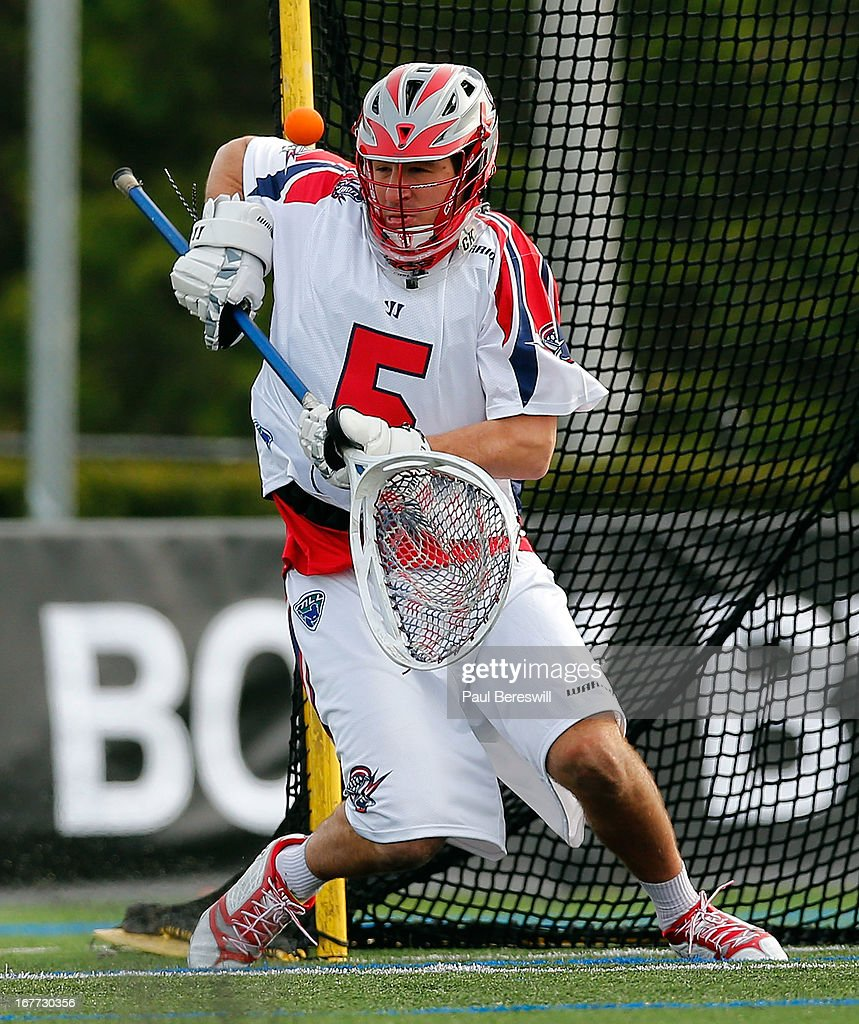 Goalie Jordan Burke #5 of the Boston Cannons makes a save off his shoulder during the 2nd half of a Major League Lacrosse game against the New York Lizzards at James M. Shuart Stadium on April 28, 2013 in Hempstead, New York.