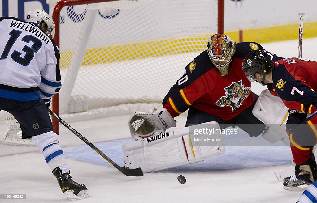 Goalie Jose Theodore of the Florida Panthers blocks a shot on goal by Kyle Wellwood of the Winnipeg Jets during the second period at the BB&T Center in Sunrise, Florida, Thursday, January 31,2013.