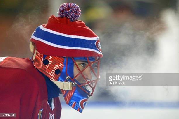 Goalie Jose Theodore of the Montreal Canadiens exhales on the ice during the game against the Edmonton Oilers in the Molson Canadien Heritage Classic...